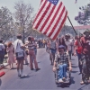 Ron Kovic (in wheelchair) and Gene Dorr (carrying flag), Vietnam Veteran\'s Parade, Westwood, Virginia, 1981