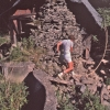 Young Man climbing on the former paper mill house, Marboro, New York