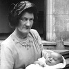 Mrs. Charles (Dorothy) Rivett holding Alastair Coe at his Christening, Dortmund, West Germany